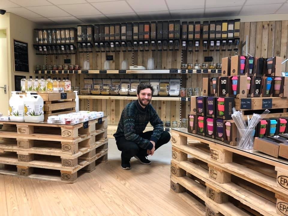 Photo of Sam Gibbons, Activities and Community Officer, in the new Zero Waste Shop in Keele Students' Union