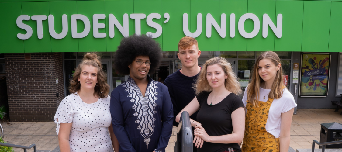 KeeleSU is closed for the foreseeable future. Image is of Amy, Leroy, Dan, Fflur and Mari (your elected officers) standing in front of the KeeleSU building.