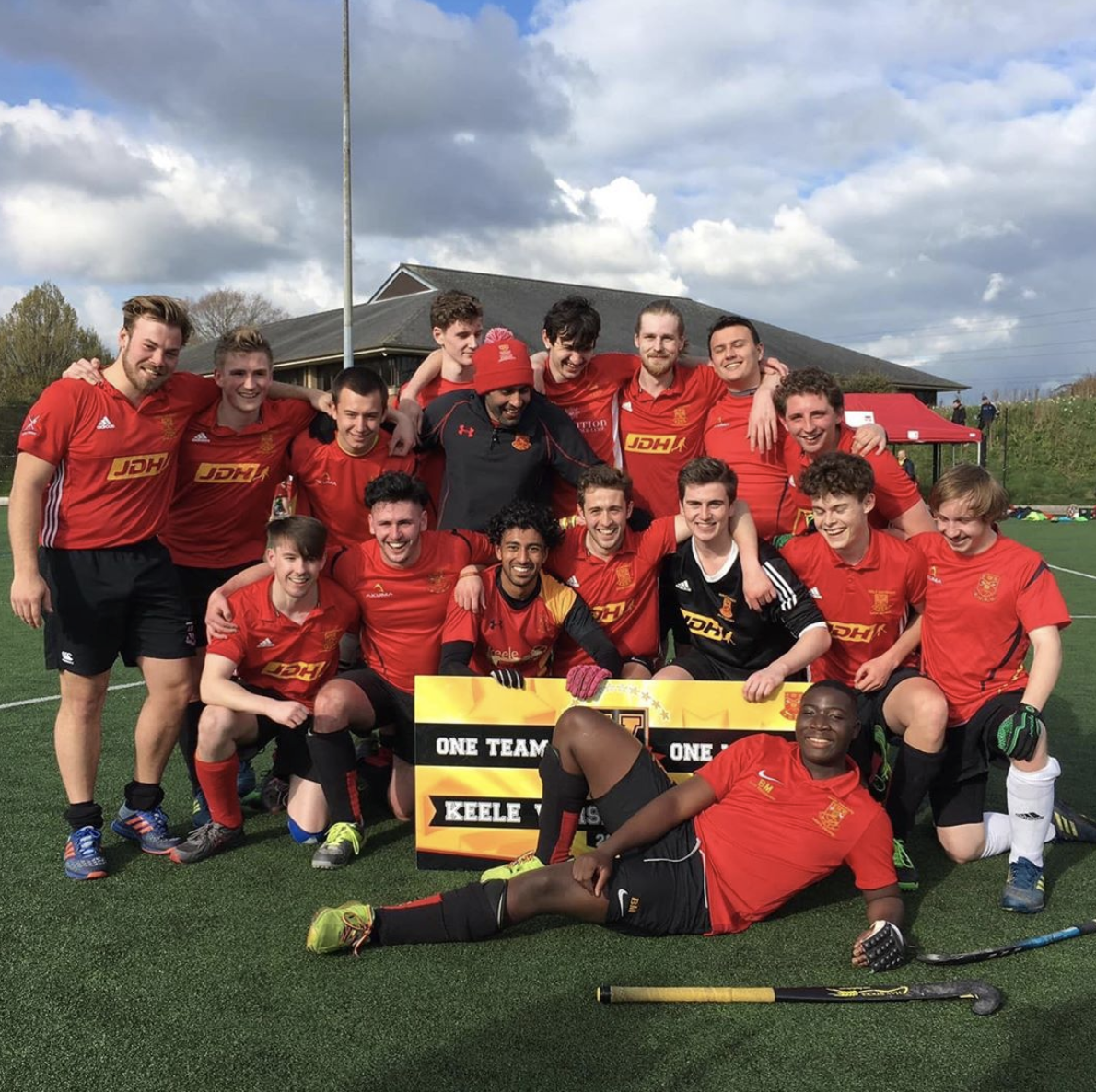 Men's hockey team with the winners varsity sign
